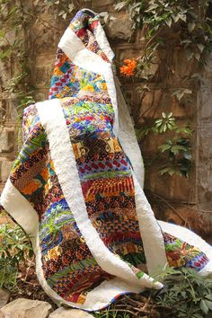 ***** omg this is the quilt I have been buying my africa prints for ****quilt from africa.  love!