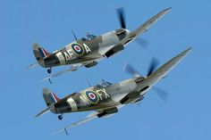 Spitfires MkVb (EP120) in the markings (AE-A) of 402 (RCAF) Sqn and Mk IX (TA805) carrying FX-M of 234 Sqn