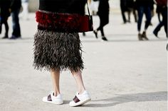 How to be fashionable: Pair sneakers with a fancy skirt or dress for an interesting high-low mix