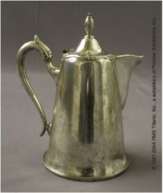 SILVER TITANIC CHOCOLATE POT: This beautiful silver chocolate pot was recovered in 1987 and painstakingly conserved to stabilize the silver surface. This pot is an amazing piece of Titanic history.  It was used to serve hot drinks (chocolate and café au lait) in the first-class restaurants aboard Titanic.