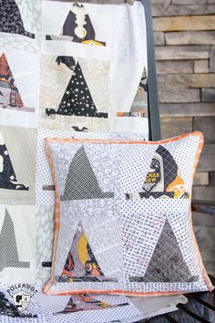 The Halloween Haberdashery Quilt; a fun Halloween sewing and quilting project featuring rows of Witch's Hat quilt blocks.