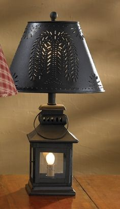 "$51.95  Check out the deal on Black Iron Lantern Lamp at Primitive Home Decors LAMP ONLY NEED SHADE--20"" Tall x 5-1/2"" Square (Base w/ wood finial)  Priced and sold individually  Three-way switch featuring a night light. Maximum wattage is 60 Watt bulb, with 6 watt bulb for nightlight. Shown with 12"" Shade (sold separately)"