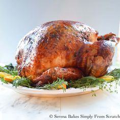 Recipe for super juicy Turkey baked in cheesecloth and white wine. With a herb butter rub.