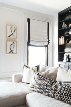 Drapery Decorating Ideas. White roman shade with black border. White sectional sofa with black and white pillows. Shannon Claire Interiors.