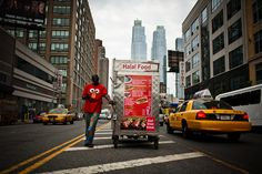 A food vendor walks up Avenue near Street. (Ramsay de Give for The Wall Street Journal) New York Minute, Night Photos, City That Never Sleeps, Photo Journal, Cheap Hotels, Night City, Love People, Color Photography, The Places Youll Go