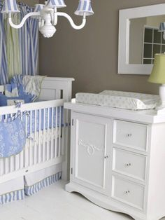 This is a cute boy nursery. I could live with this. Love the light and the blues, whites, tans and greens.