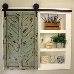 Our tiny half bath was in need of some storage and these lovely built-in cabinets provided the perfect solution. Check out the details on… Barn Door Cabinet, Sliding Cabinet Doors, Bathroom Barn Door, Diy Barn Door, Diy Door, Barn Door Hardware, Office Bathroom, Bathroom Closet, Diy Built In Shelves
