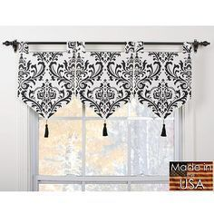 These valances feature a classic look suitable for any decor. This valance set is fully lined and is finished with black tassels.