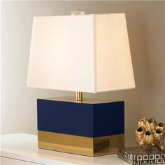 NEED – I NEED a little sexy in every room and this navy lacquer and brass, contemporary rectangle table lamp does the job! http://www.shadesoflight.com/short-brass-and-lacquered-modern-table-lamp.html $650.00