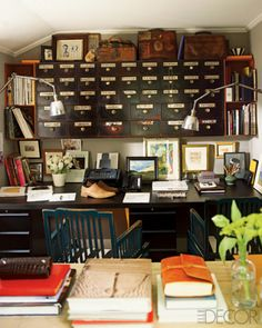 In the home office, a desk designed by Lambertson and Truex, an apothecary-cabinet storage unit, and factory lights from Privet House; paintings by Truex, vintage commercial art, and sample footwear from the Lambertson Truex men's collection are displayed throughout.