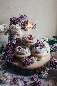 Lavender cupcakes from Cupcake Royale dressed in lovely lilacs from around the neighborhood.