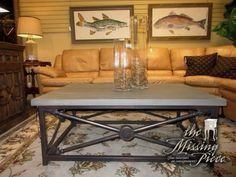 """Steven Shell Agincourt coffee table in a distressed black metal with gray top. The base has an arrowhead detail all around. Super interesting look! Would be nice in a more industrial style space. 47""""L x 31""""D x 19""""H."""