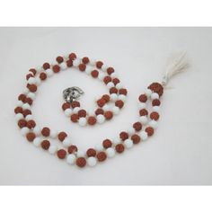 Rudraksha White Agate Full Mala Prayer Yoga Meditation Japa Mala 108 + 1 with Silver Om Pendant mogul interior, http://www.amazon.com/dp/B00A751LYW/ref=cm_sw_r_pi_dp_qK8Oqb19G04JN