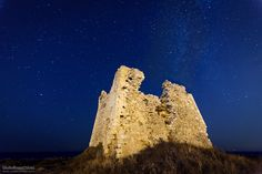 "Saracen Tower by Night - Old Saracen tower in the night, under the stars of Puglia, Italy.  Press ""H"" for View on Black  © All Right Reserved"