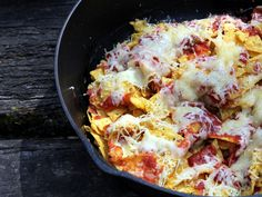 Get creative with toppings on your campfire nachos cooked to perfection in a cast iron skillet.
