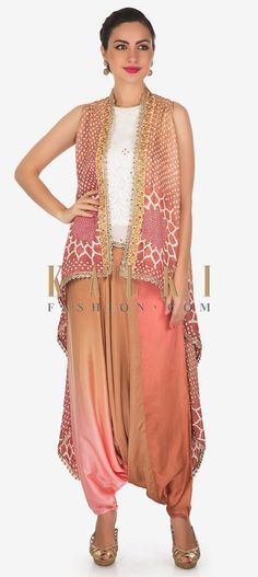 Buy Online from the link below. We ship worldwide (Free Shipping over US$100)  Click Anywhere to Tag Begie and peach dhoti suit matched with bandhani printed jacket only on Kalk Featuring this comfortable beige and peach dhoti pant suit in satin.The stripe sleeve top in white is enhanced in lucknowi thread work along with zari embroidered armhole.Matched with bandhani printed jacket with zari lace. Fashion Show Dresses, Thread Work, Print Jacket, Peach, Beige, Crop Tops, Free Shipping, Suits, Printed
