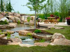 Fish Ponds Rochester NY, Koi Ponds - Backyard Pond and Waterfalls Rochester, Pondless Waterfall Construction by Acorn landscaping in Rochester New York