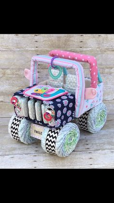 Want a gift NO ONE else will have?? This diaper jeep is PERFECT for your next baby shower! Whether youre looking for a unique baby gift, or an INCREDIBLE diaper centerpiece, this diaper cake is sure to be a crowd pleaser!! These diaper centerpieces are the perfect touches to tie in your baby shower decorations!! **********I have recently started making my own recieving blankets which gives ENDLESS possibilities for custom themes!! There are many options at checkout, please be sure to ask me…