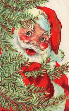Peeking Santa from behind the Christmas tree