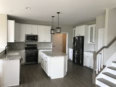 Luxury Black or Stainless Appliances with White Cabinets