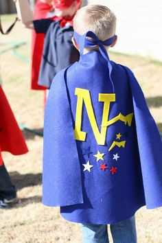 super hero cape with stickers in bags for the kids to decorate their own cape when they get to the party