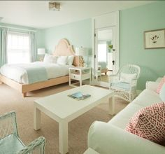 love the sea-foam green, sand, and coral color palette of this bedroom