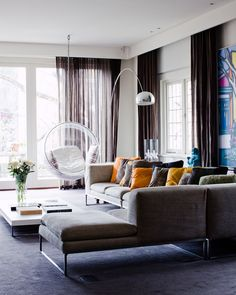 Two classics in one room - the Adelta Bubble Chair http://www.nest.co.uk/search/adelta-bubble-chair and the Flos Arco Floor Lamp http://www.nest.co.uk/product/flos-arco-floor-lamp