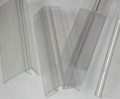 Clear polycarbonate profiles used in installation of polycarbonate sheets. H profile for between sheets. F profile for flashing or corners. R profile for corners and U profile to close off the ends of the channels.