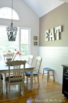 This plank wall made such a statement in this kitchen makeover. DIY project that was well worth it.