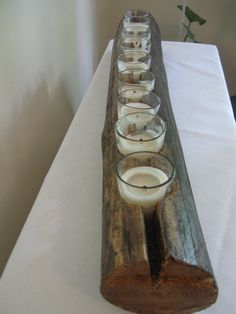 2ft long-Table OR Hanging Tree Branch Candle Centerpiece/ Unique Gift / Wooden Candleabra Lighting. $52.00, via Etsy.