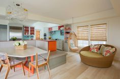 Seating area for dining with fantastic lightshade and colour accents   | Usual House