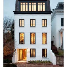 I have this thing for white brick and black windows . Classy and modern