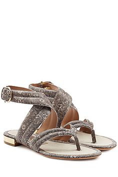 Salvatore Ferragamo's tactile leather sandals have bene printed with an exotic snakeskin design, lending a sophisticated air to the cross-over strap and glossy gold-tone heel #Stylebop