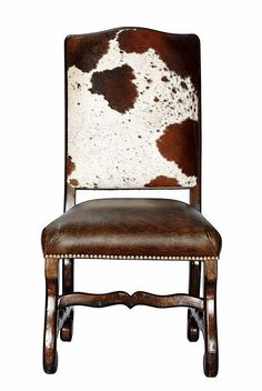 Hand Carved Frame in Cowhide back, Genuine Distressed Leather seat with individually Hand tacked Brass Nails.  https://www.houzz.com/photos/80921897/Classic-Cowhide-Chair-Set-of-4-southwestern-dining-chairs
