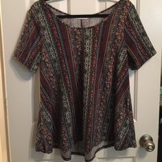 Tribal / Floral Top FINAL PRICE This top is very flattering! It is smaller at the waist and flows out at the bottom. Pretty patterns all over. Only worn a few times. Not sure what the material is but its stretchy and soft - not thin though. There is also no size on it but I wore an XL size when I wore this top. r2d apparel Tops Tees - Short Sleeve