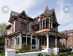 Beautiful colorful wooden Victorian style residential building with porch and balcony on a bright summer spring day. Victorian Style Homes, Victorian Houses, Victorian Buildings, Porch And Balcony, Second Empire, Victorian Architecture, Victorian Fashion, Victorian Ladies, Victorian Era