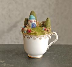 Tiny Fairy Houses and Village, Waldorf Fairy Garden in a Cup, Needle Felted. $46.00, via Etsy.  By gingerlittle of Omaha, Nebraska, USA.