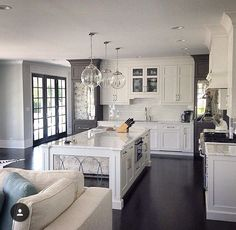 Floor is a bit dark, but love the mirrored accent doors and island face, contrasting colors stand out nicely.