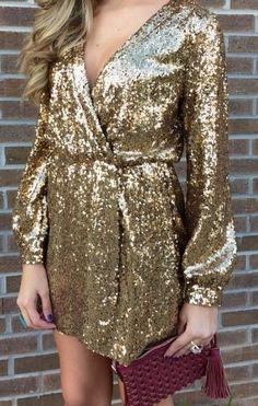 A New Year's Eve outfit wouldn't be complete without some glitter and shine. Try a sequined wrap dress with long sleeves. | Click to see other amazing holiday dress ideas.