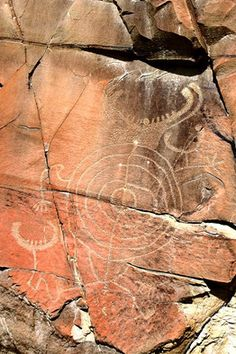 30 miles northwest of Thermopolis, Wyo.    Ice Age paintings and carvings in Europe are revered as sublime achievements of early humans, yet the prehistoric rock art in the American West is far less known. At Legend Rock in central Wyoming, 10,000 years of profound beliefs are inscribed on red sandstone cliffs