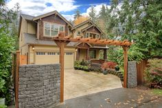 Exquisite private retreat featuring beautiful entrance with stone, cedar fencing & arbor & cedar privacy fencing enclosing the natural grounds on 1/2 acre with serene creek. This custom home feels so private, yet close to everything at the south end of Lake Sammamish! Builder's own home with all the upgrades!