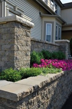 Decorative Block Wall split-face block wall with decorative columns and caps | garden