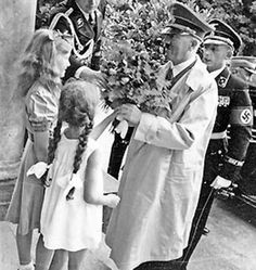Girls giving flowers to Adolf Hitler