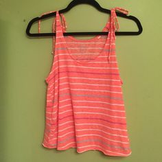 Coral Stripes Tank Top Coral tank top with white, gray, and pink stripes. Size medium but fits like a small. Shoulders tie almost like a bikini, so the sizing is very adjustable. Wore this once. It's in brand new condition. Soft material. Lilu Tops Tank Tops