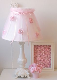 "Lamp shade ""slip-covered"" with sheer fabric, then silk roses (ribbon craft?) added."