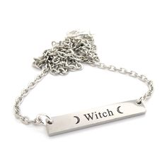 'Witch' engraved pendant on a silver tone chain necklace.Stainless steel pendant measures 30mm wide.We love layering this dainty necklace with our Moon Spell Necklace for an extra witchy layered look!Pendant: stainless steel.Materials: Silver tone zinc alloy.Copyright © 2015 Empty Casket LTD
