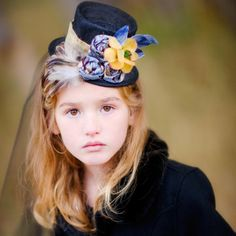 Victorian mini top hat is so striking with colors of dusty blue, brown and tan.  Whimsical feathers add depth and vintage flowers add simple style.  This hat is available with or without veiling.