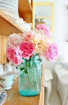 Flowers in blue mason jar