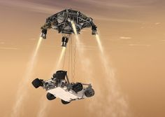 """FILE - In this 2011 file artist's rendering provided by NASA/JPL-Caltech, a """"sky crane"""" lowers the Mars Science Laboratory Curiosity rover onto the surface of Mars. After traveling 8 1/2 months and 352 million miles, Curiosity will attempt a landing on Mars the night of Aug. 5, 2012."""