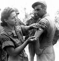 an U.S. soldier got a vaccine from a nurse
